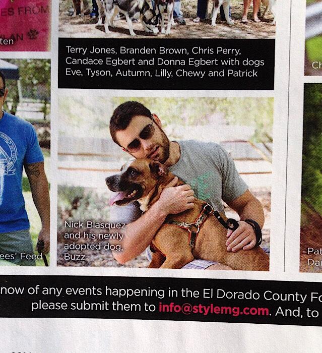 Man holding boxer dog for Style Magazine
